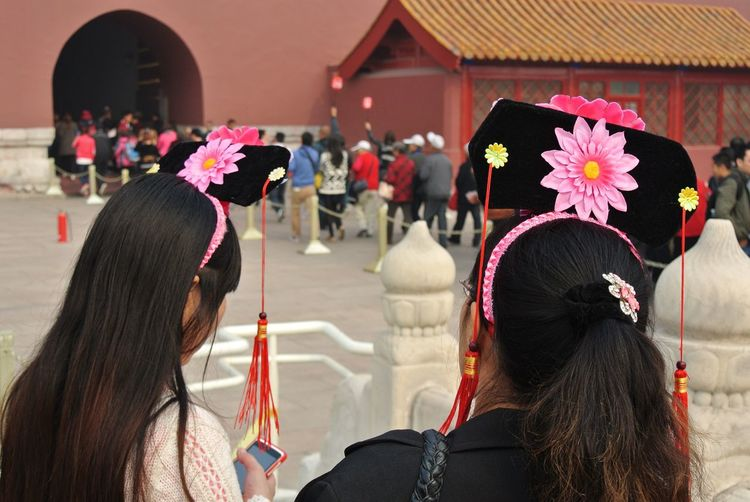 Rear View Of Women With Headbands At Forbidden City