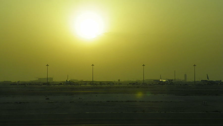 Desert sand in the air covering the rising sun Airplane Airplanes Airport Aviation Desert Sun Desert Sunrise Desert Sunset Dust Dust In The Air EyeEmNewHere Gold Colored No People Silhouettes Sky Sun ındustry