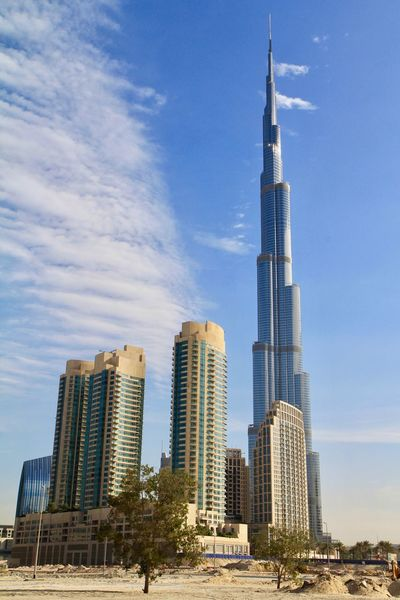 Architecture Tall - High Building Exterior Skyscraper Built Structure Sky Tower Day Modern Outdoors Tall City Low Angle View No People Urban Skyline Urban Geometry Urban Landscape Desert Check This Out Sunset Golden Hour in Dubai , UAE MISSIONS: