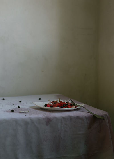 High angle view of fruits on table against wall