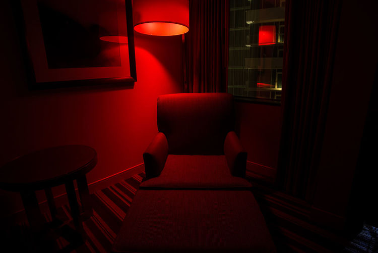 Empty Chair In Illuminated Room