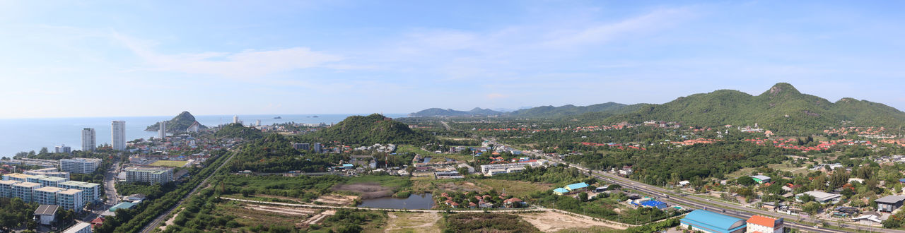 Dramatic atmosphere panorama aerial view of beautiful Hua Hin beach resort town at southern part of Thailand in summer season. Architecture Building Building Exterior Built Structure City Cityscape Cloud - Sky Day High Angle View Landscape Mountain Nature No People Outdoors Panoramic Plant Residential District Scenics - Nature Sea Sky Travel Destinations Tree