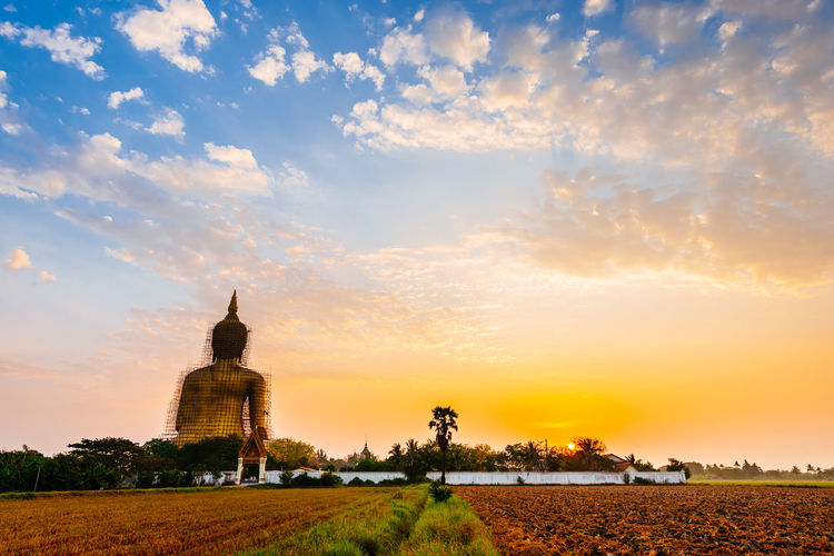 golden sky over the golden buddha Sunset Business Finance And Industry Religion Sky Architecture Place Of Worship Countryside