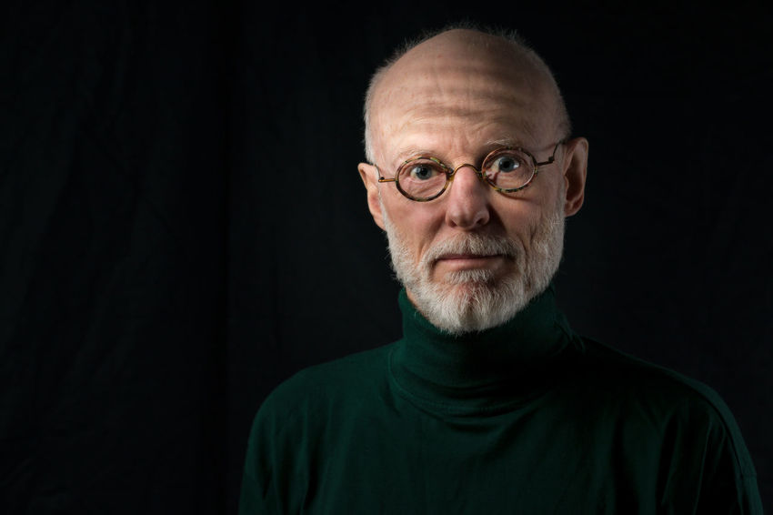 portrait of mature man adult expressive Adult Adults Only Beard Black Background Eyeglasses  Filtered Light Headshot Looking At Camera One Man Only One Person One Senior Man Only Only Men People Portrait Senior Adult Studio Shot Venetian Blinds Window Light