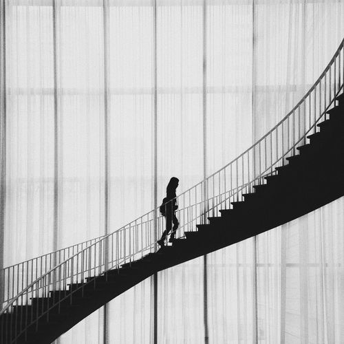 Silhouette Woman Walking On Stairs