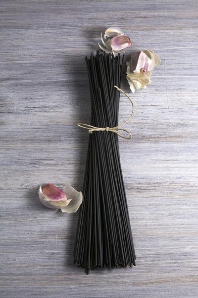 Raw black spaghetti with squid ink Diet Dark Mediterranean Food Modern Raw Squid Ink Squid Ink Pasta Black Dry Noodles Food Gastronomy Gralic Braid Ink Nutritive Recipe Rough Sepia Spaguetti