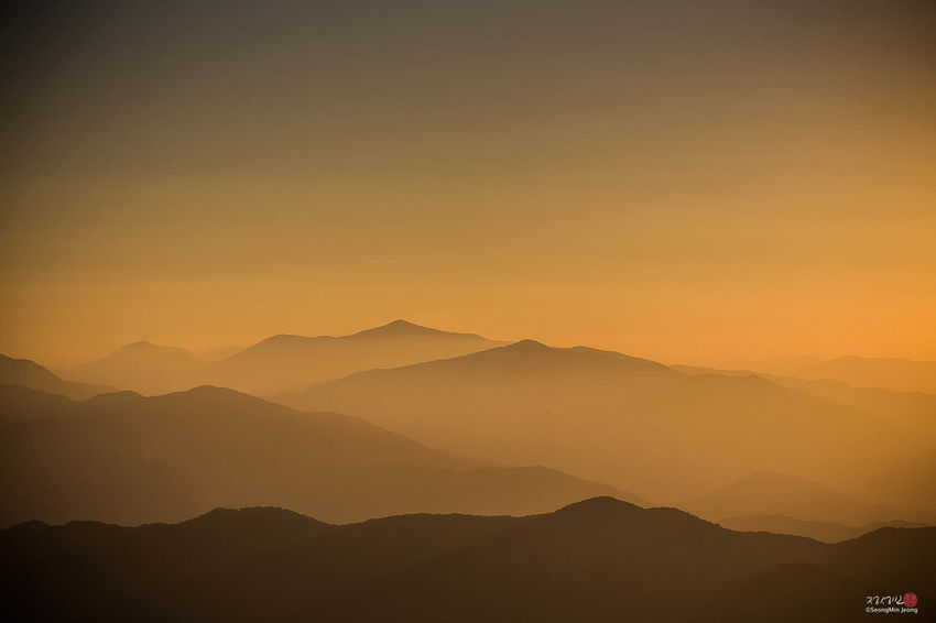 Beauty In Nature Dawn Day Fog Landscape Mountain Mountain Range Nature No People Outdoors Scenics Silhouette Sky Tranquil Scene Tranquility Travel Destinations