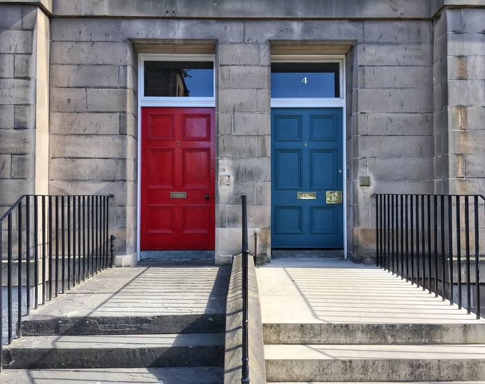 EyeEm Best Shots - The Streets EyeEm Best Shots - Architecture Symmetry EyeEm Best Shots Red Architecture Building Exterior Built Structure Door Entrance Building Closed No People House Blue Day City Residential District Outdoors Wood - Material