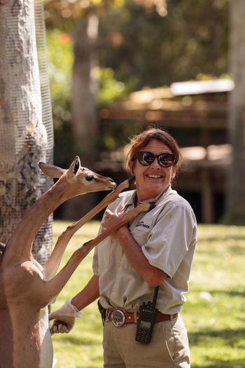 San Diego, CA, USA - October 6, 2017: Southern Gerenuk gives a member of the San Diego Zoo Safari park staff love and affection. Editorial only. Caretaker Litocranius Walleri Love San Diego Zoo Southern Gerenuk ZooKeeper Affectionate Antelope Day Mammal One Animal One Person Outdoors Real People Safari Park Young Adult