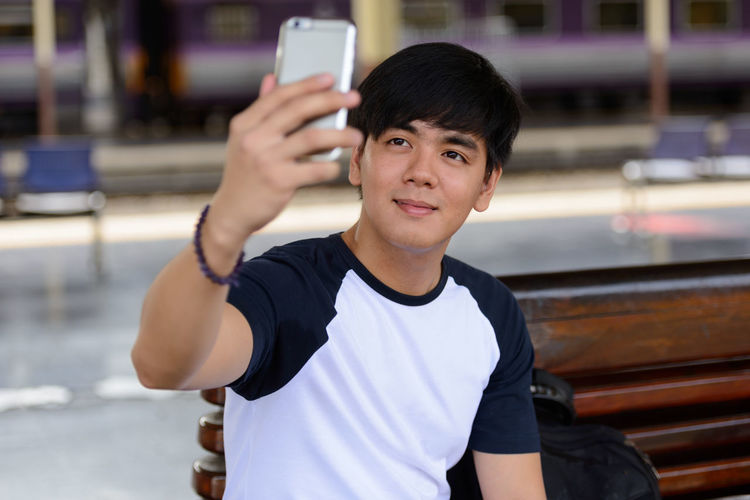 Portrait of young man using mobile phone