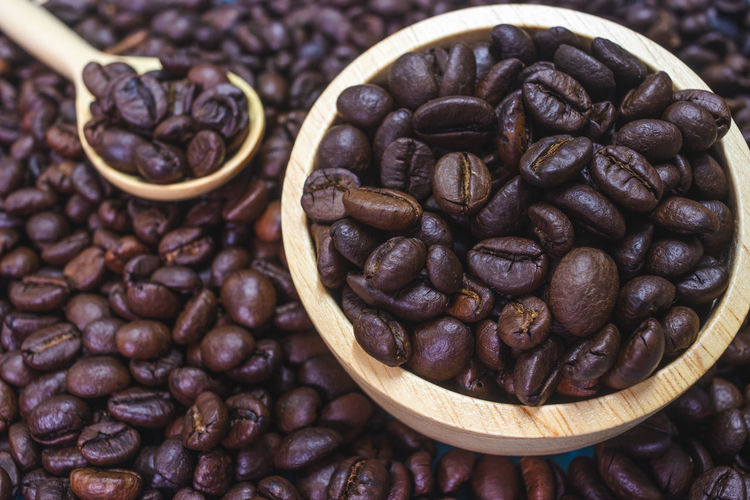 Food And Drink Food Coffee - Drink Coffee Roasted Coffee Bean Freshness Large Group Of Objects Still Life Brown Abundance No People Indoors  Close-up High Angle View Coffee Bean Focus On Foreground Container Table Cup Roasted Caffeine