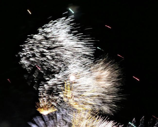 Night Firework Motion Long Exposure Firework Display Celebration Illuminated Arts Culture And Entertainment Event Blurred Motion Exploding Sparks Firework - Man Made Object Glowing Burning Nature Smoke - Physical Structure Low Angle View No People Outdoors Light Sparkler