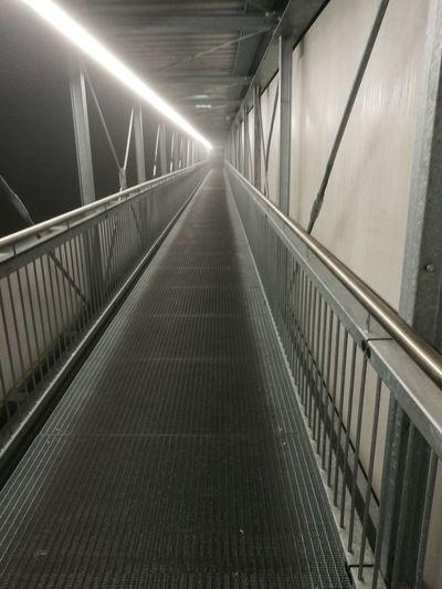 Illuminated footbridge at night