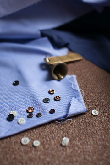 High Angle View Of Buttons On Fabric