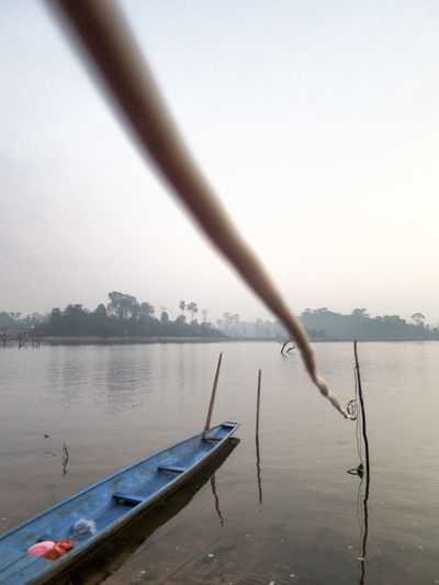 Wandering around the waters edge as we were waiting to watch the sun rise. Beauty In Nature Blue Boat Cloud - Sky Day Depth Of Field Laos Nature Nautical Vessel No People Outdoors Perspective Sky Tranquility Tree Water