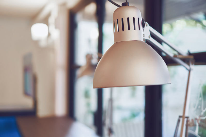 Vintage gray desk lamp on the table in coffee cafe. Antique Architecture Electric Hanging Home Isolated Light Power Retro Background Bulb Bulbs Concept Decoration Decorative Design Electricity  Energy Glass Idea Lamp Lightbulb Luxury Restaurant Vintage