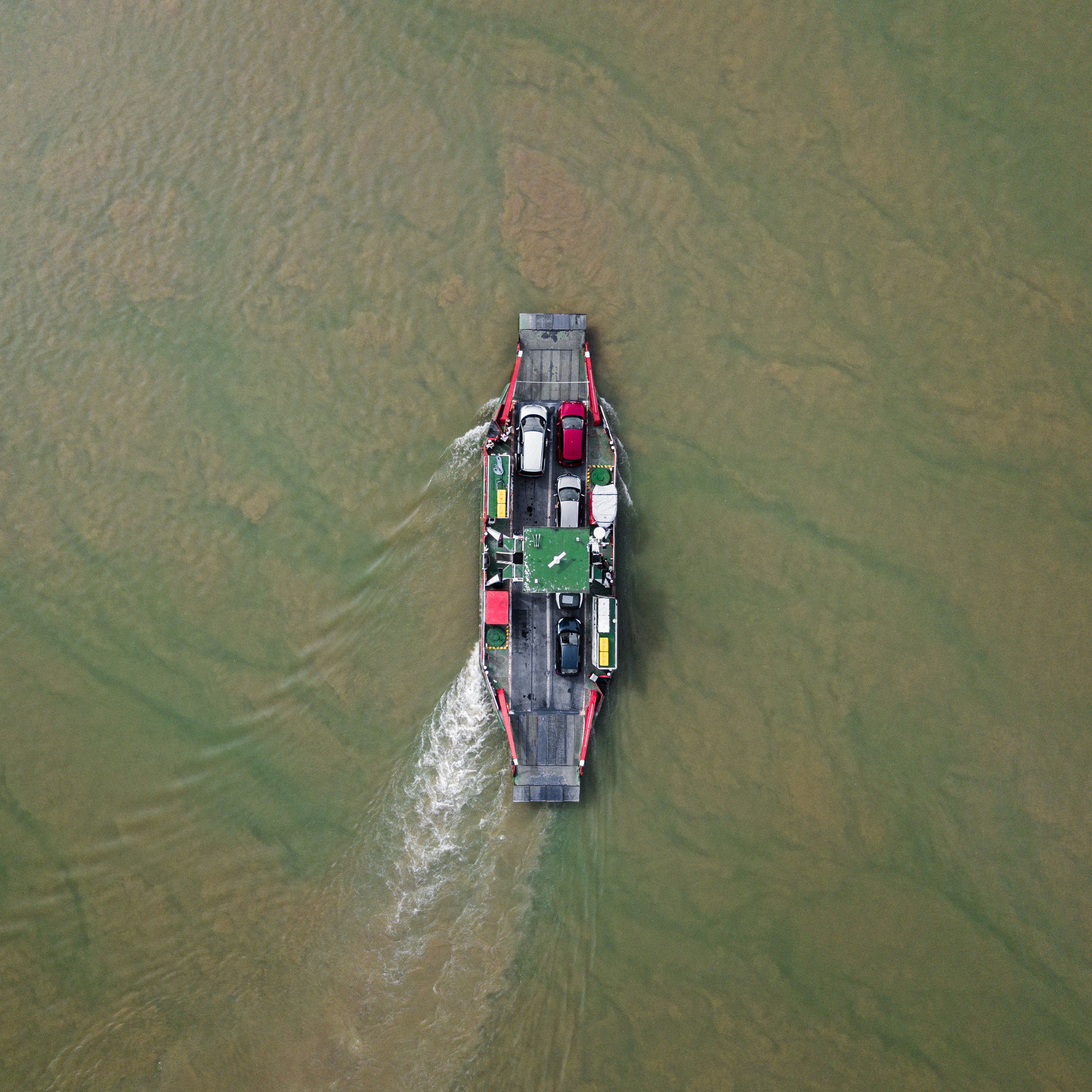 water, transportation, mode of transportation, high angle view, nautical vessel, day, waterfront, nature, aerial view, outdoors, sea, beauty in nature, no people, green color, scenics - nature, travel, land, motion