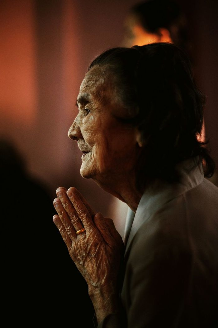 Side view of senior woman with hands clasped
