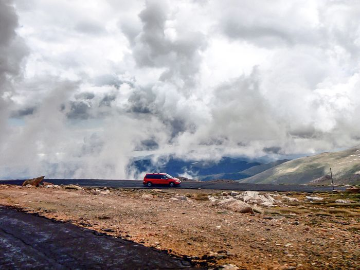 Red Car Check This Out Taking Photos Enjoying Life Minivan Pikes Peak Colorado Winding Road Clouds And Sky