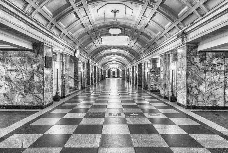 Empty corridor in illuminated subway station