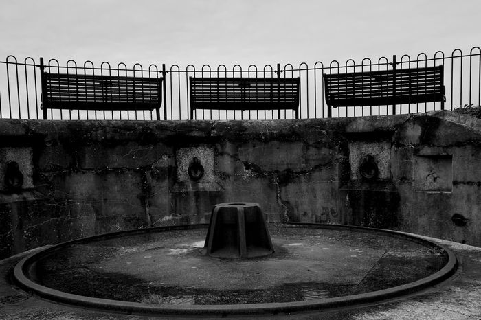 Three Empty Benches Built Structure Architecture Sky No People Railing Day History Old The Past Outdoors Wall Metal Park Bench Blackandwhite