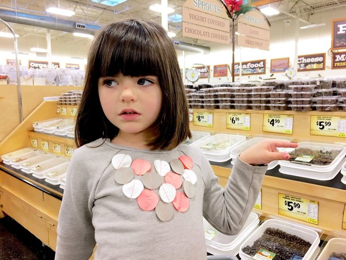 Girl at grocery store Bangs One Person Looking At Camera Child Retail  Portrait One Girl Only Store Childhood Children Only Indoors  People Supermarket Adult