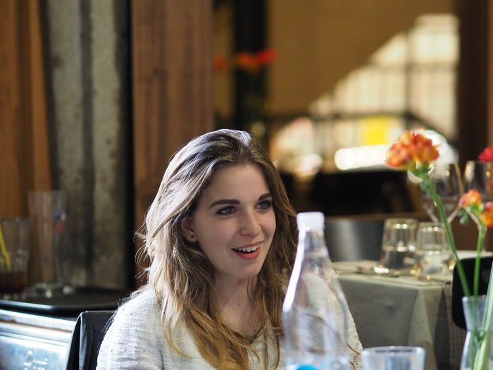 Portrait of smiling young woman at restaurant