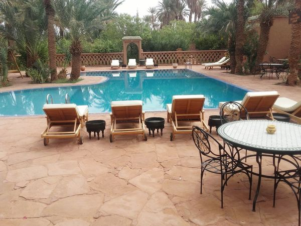 Live For The Story Swimming Pool Outdoor Chair Summer Luxury Hotel Vacations Outdoors Sand Sky Mhamid El Ghizlane Tranquility Ouarzazate Morocco