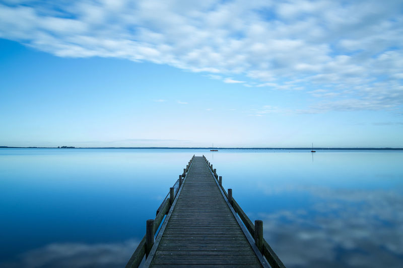 ✨Blue silence✨Enjoy the silence by. Depeche Mode✨Transportation Wood Paneling Waterfront Walkway Horizon Over Water capturing motion Pier Eyeem Market From My Point Of View EyeEm Gallery Cloud - Sky Blue Sky Sea Tranquility Tranquil Scene Reflection Water Cloud Loneliness Solitude Beauty In Nature Idyllic Steinhuder Meer Long Goodbye The Secret Spaces The Great Outdoors - 2017 EyeEm Awards BYOPaper! Let's Go. Together. Sommergefühle EyeEm Selects Neon Life Breathing Space Investing In Quality Of Life EyeEmNewHere The Week On EyeEm Your Ticket To Europe Mix Yourself A Good Time Been There. Discover Berlin Done That. Lost In The Landscape Connected By Travel Second Acts Perspectives On Nature Rethink Things Postcode Postcards Be. Ready. Step It Up One Step Forward EyeEm Ready   AI Now An Eye For Travel The Graphic City Mobility In Mega Cities Colour Your Horizn Modern Workplace Culture Stories From The City Go Higher Inner Power Visual Creativity Summer Exploratorium Going Remote Focus On The Story #FREIHEITBERLIN Modern Hospitality Creative Space Love Is Love The Troublemakers Summer Road Tripping Summer Sports Love The Game My Best Travel Photo A New Beginning This Is Natural Beauty Holiday Moments A New Perspective On Life Capture Tomorrow Human Connection Moments Of Happiness It's About The Journey My Best Photo Humanity Meets Technology 17.62°
