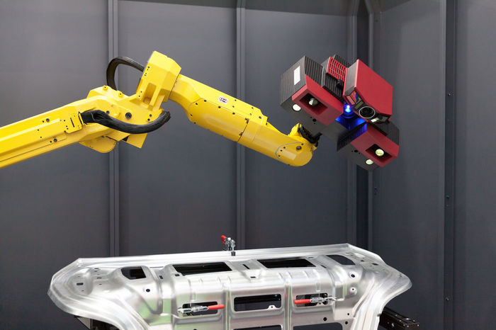 Robotic arm with 3D scanner. Automated scanning. 3D Camera Industrial Industry Machine Measuring Metrology Automated Automation Computer Control Coordinate Data Factory Inspecting Inspection Manufacturing Measurement Optical Robot Robotic Arm Scan Scanner  Scanning Technology