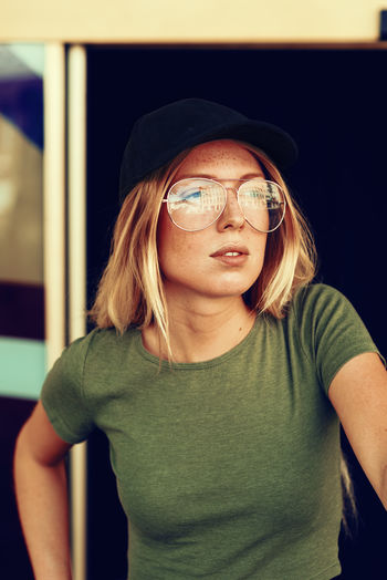 young college girl Authentic Moments Glasses Green American Apparel Cap College Girl  Leisure Lifestyles Long Hair Looking Outdoor People Relaxing Moments Shirt Vintage Women Young Adult Young Women