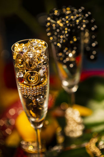 Celebrational Abundance Abundance Wealth Celebration Decoration Jewelry Pearls Glass Alcohol Refreshment Drink Food And Drink Focus On Foreground Close-up Champagne Indoors  Drinking Glass Champagne Flute No People Wine Glass - Material Table Household Equipment Still Life Luxury Freshness Cocktail Nightlife Ornate Martini