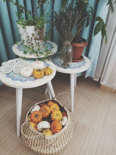 Fruits and potted plants on table at home