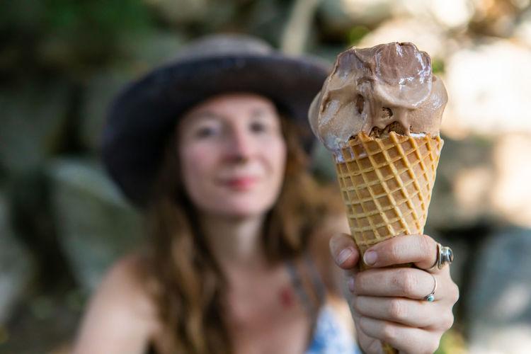 Portrait of woman holding ice cream cone