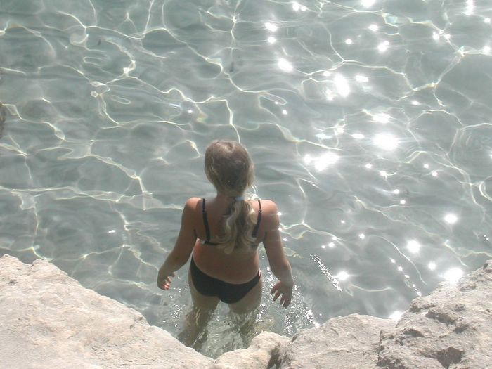 High Angle View Of Woman Standing In Shallow Water