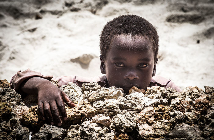 ADMIRING Looking At Things Portrait Of A Woman Public Beach The Week on EyeEm Africa Day To Day Boys Childhood Eyeem Beach Shots Front View Hope For A Better Future Innocence Lifestyles Looking At Camera Nature One Person Portrait Son Of A Fisher