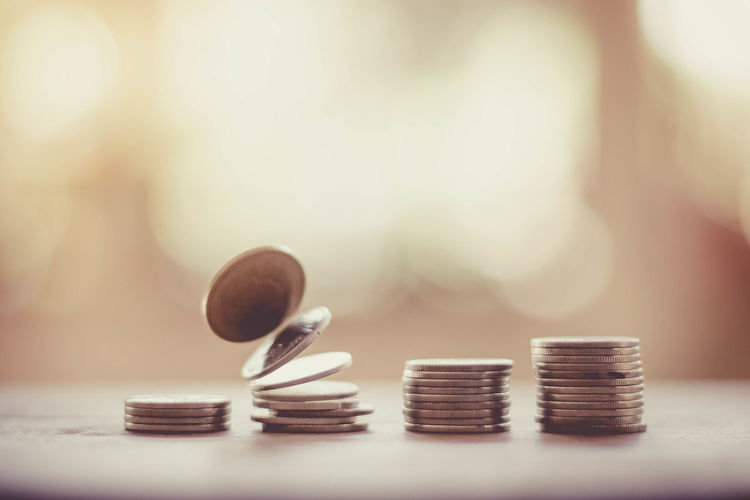 Save money and investment concept with coin stack growing graph with sunlight Economy Growth Light Loan  New Accounting Business Cash Coin Concept Currency Economy Finance Keep It Blurry Money No People Save Stack Wealth