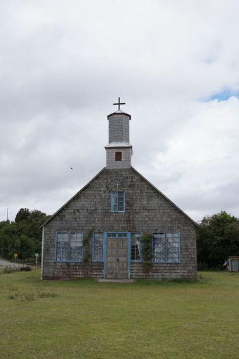 Church on field against sky