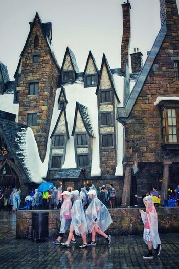 Travel Destinations Architecture Built Structure People Building Exterior USAtrip Orlando Florida Wizarding World Of Harry Potter Wizard Miracle Rainy Days Rain Travel Photography Fantasy Hogsmeade Winter Wintertime Rooftop Roof Snow Happy New Year! Large Group Of People Vintage Style Vintage Architecture