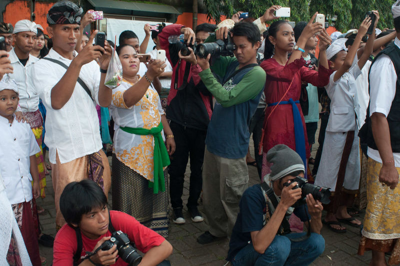 People photographing with mobile phones