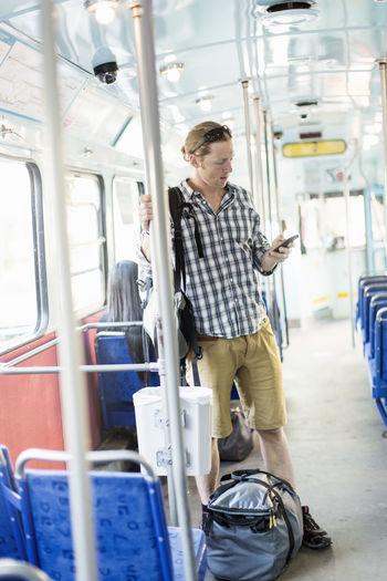 Men sitting in train