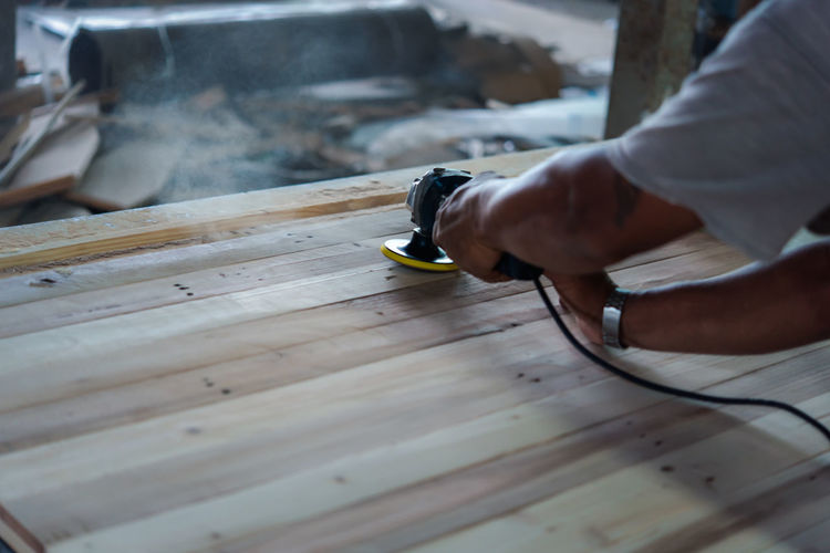 Close-up of man working on table