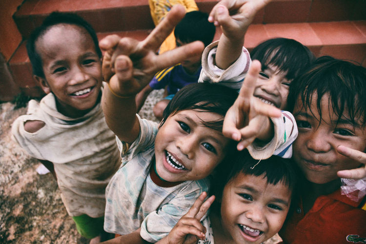Happiness of poor children on highlands. Children Happiness Happy Life Cheerful Child Childhood Day Enjoyment Friendship Fun Happiness Leisure Activity Lifestyles Looking At Camera Outdoors People Poor Children Portrait Portrait Of Children Real People Smiling Togetherness