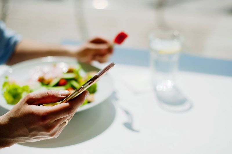 young guy eating a salad Human Hand Hand Human Body Part One Person Indoors  Food And Drink Holding Focus On Foreground Freshness Plate Women Real People Body Part Food Lifestyles Healthy Eating Close-up Table Adult Finger
