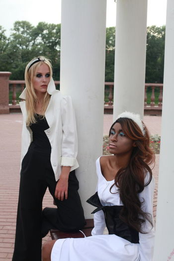 Fashion Models Standing At Park