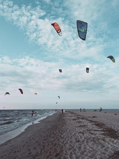 Kitesurfers on the beach on cloudy day