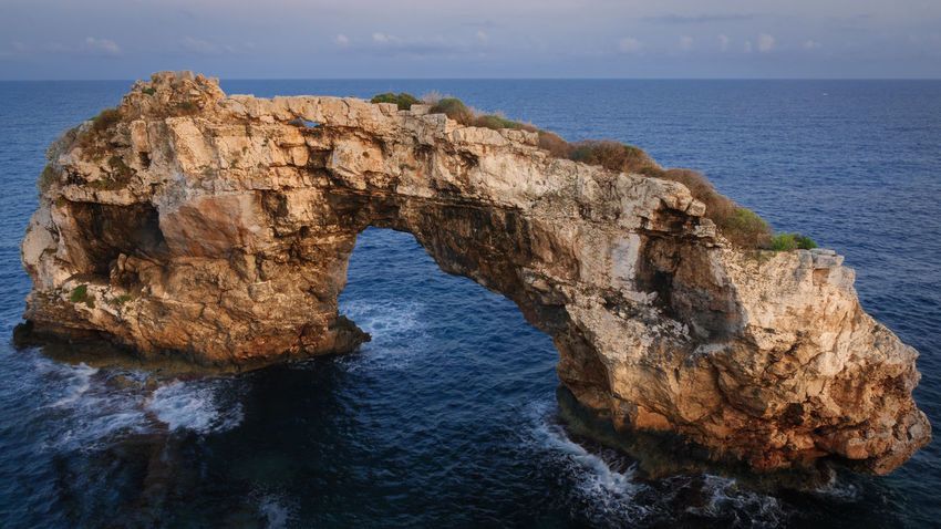 Sea Water Rock Natural Arch Rock - Object Horizon Over Water Beauty In Nature Scenics - Nature Horizon Arch Solid Rock Formation Sky Tranquil Scene Nature Land Tranquility No People Idyllic Outdoors Eroded Es Pontàs