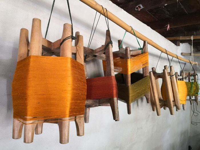 Close-up of clothes hanging on wooden table