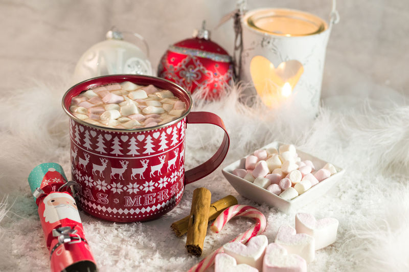High Angle View Of Hot Chocolate On Table With Christmas Decoration