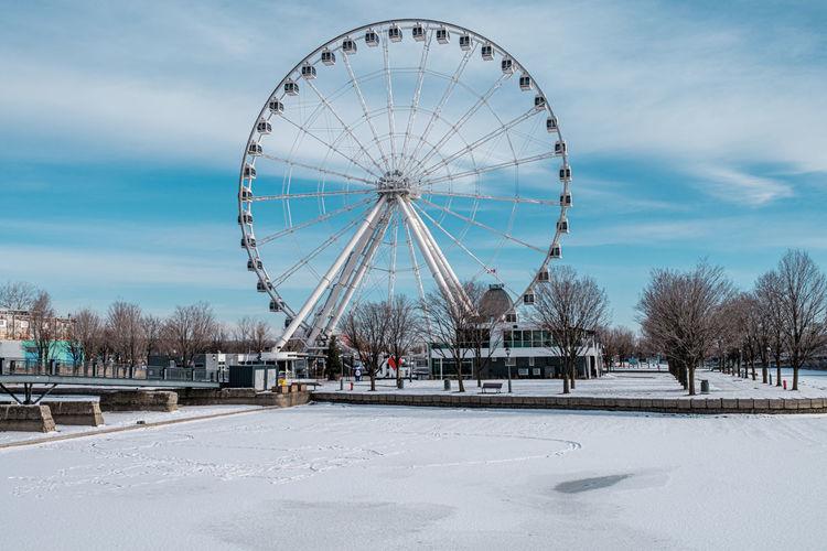 Ferris wheel against sky during winter